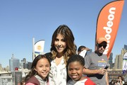 Breanna Yde, Daniella Monet and Benjamin Flores Jr. attend the Nickelodeon And NFL Play 60 At The Intrepid on September 17, 2013 in New York City.
