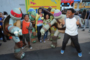 The Teenage Mutant Ninja Turtles pose for a picture with Benjamin ÒLil P-NutÓ Flores Jr, Amber Montana, Amani Toomer, Breanna Yde and Curtis Harris Jr at the NYRoad Runner Club in Times Square host Nickelodeon themed 5 borough relay race on September 20, 2013 in New York City.