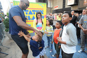 (L-R) Amani Toomer,  Amani Jr. Toomer, Jasmine Toomer, Amber Montana, Breanna Yde, Benjamin Flores Jr and Curtis Harris Jr attend the NYRoad Runner Club in Times Square host Nickelodeon themed 5 borough relay race on September 20, 2013 in New York City.