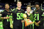 (L-R) NFL players Stefon Diggs, Luke Kuechly, actor Ricardo Hurtado and former NFL player Deion Sanders attend the Superstar Slime Showdown taping at Nickelodeon at the Super Bowl Experience on February 1, 2018 in Minneapolis, Minnesota.