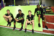 (L-R) NFL players Luke Kuechly and Stefon Diggs, actor Ricardo Hurtado and former NFL player Deion Sanders attend the Superstar Slime Showdown taping at Nickelodeon at the Super Bowl Experience on February 1, 2018 in Minneapolis, Minnesota.