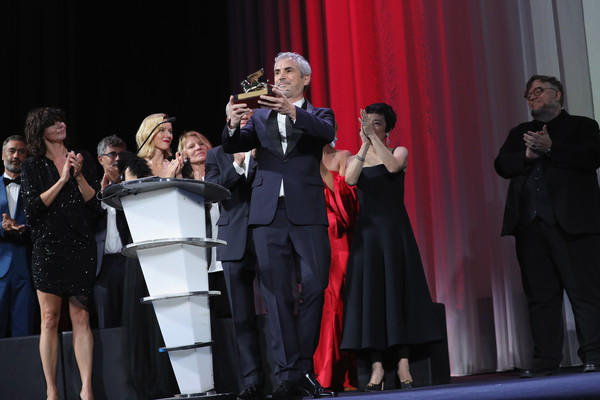 Award Ceremony - 75th Venice Film Festival [entertainment,performance,event,performing arts,music,musical ensemble,dress,stage,performance art,singing,alfonso cuaron,sala grande,venice,italy,golden lion for best film award for roma,award ceremony,venice film festival]