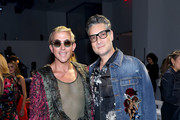 Derek Warburton (L) and Cameron Silver attend the Nicole Miller front row during New York Fashion Week: The Shows at Gallery II at Spring Studios on September 08, 2019 in New York City.