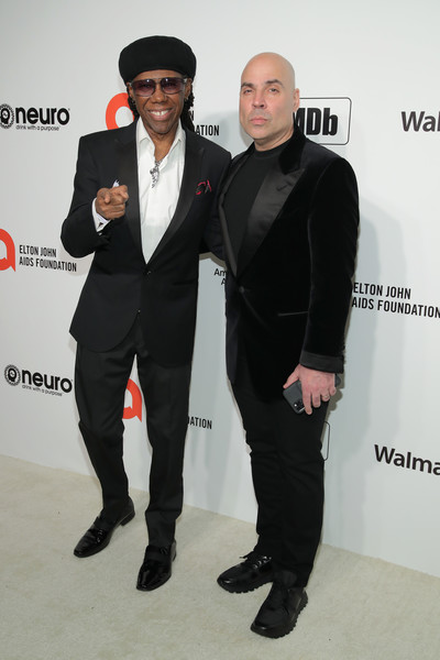 28th Annual Elton John AIDS Foundation Academy Awards Viewing Party Sponsored By IMDb, Neuro Drinks And Walmart - Arrivals [suit,formal wear,fashion,tuxedo,event,premiere,outerwear,fashion design,carpet,white-collar worker,neuro drinks,arrivals,elton john aids foundation academy awards viewing party,nile rodgers,l-r,west hollywood,california,walmart,imdb,merck mercuriadis,nile rodgers,merck mercuriadis,2019 rock in rio,rock roll hall of fame,photograph,livingly media,image,actor,elton john aids foundation,rock]