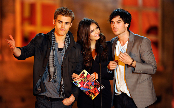 "Nina Dobrev (L-R) Actors Paul Wesley, Nina Dobrev and Ian Somerhalder present the award for Best Horror Actress onstage during Spike TV's ""Scream 2010"" at The Greek Theatre on October 16, 2010 in Los Angeles, California."
