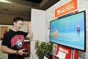 Nolan Gould checks out 'Pokémon Sword and Pokémon Shield' for the Nintendo Switch system during the 2019 E3 Gaming Convention at Los Angeles Convention Center on June 12, 2019 in Los Angeles, California.