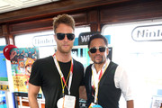Actors Jake McDorman (L) and Hill Harper attend The Nintendo Lounge on the TV Guide Magazine yacht during Comic-Con International 2015 on July 9, 2015 in San Diego, California.