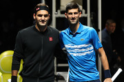 Roger Federer of Switzerland and Novak Djokovic of Serbia pose for a photo at the net prior to their singles match during Day Five of the Nitto ATP World Tour Finals at The O2 Arena on November 14, 2019 in London, England.