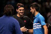 Roger Federer of Switzerland and Novak Djokovic of Serbia embrace at the net after their singles match during Day Five of the Nitto ATP World Tour Finals at The O2 Arena on November 14, 2019 in London, England.