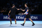 Bruno Soares of South Africa and Jamie Murray of Great Britain react during their match against Michael Venus of New Zealand and Raven Klaasen of South Africa during Day One of the Nitto ATP World Tour Finals at The O2 Arena on November 11, 2018 in London, England.