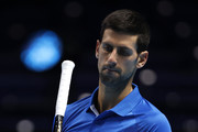 Novak Djokovic of Serbia serves looks dejected his singles semi final match against Dominic Thiem of Austria during day seven of the Nitto ATP World Tour Finals at The O2 Arena on November 21, 2020 in London, England.