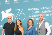 Director Guillermo Arriaga (L), Isabel Aerenlund (second right) and guests attend 'No One Left Behind' photocall during the 76th Venice Film Festival at Sala Grande on August 30, 2019 in Venice, Italy.