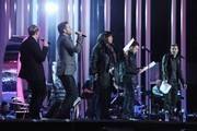 Kian Egan, Mark Feehily, Shane Filan and Nicky Byrne sing with Donna Summer (center)  during the Nobel Peace Prize Concert Rehearsals at Oslo Spektrum on December 10, 2009 in Oslo, Norway.