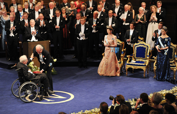 Swedish poet Tomas Transtromer (L) receives the Nobel Prize for Literature from King Carl XVI Gustaf of Sweden (2 L) at the Nobel Prize Award Ceremony at Stockholm Concert Hall on December 10, 2011 in Stockholm, Sweden.