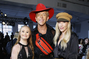 Madeline Stuart, Derek Warburton and Julie Mintz attend the Nonie fashion show during September 2018 New York Fashion Week: The Shows at Industria Studios on September 9, 2018 in New York City.