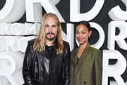 Marco Perego and Zoe Saldana attend the Nordstrom NYC Flagship Opening Party on October 22, 2019 in New York City.