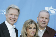 Conductor John Mauceri , Nancy Sinatra, and Frank Sinatra Jr. pose at the Hollywood Bowl for the Sixth Annual Hollywood Bowl Hall of Fame Induction Ceremony, on June 24, 2005, in Los Angeles, California.