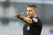 Referee Robert Jones in action during The Emirates FA Cup First Round match between Northampton Town and Scunthorpe United at Sixfields on November 4, 2017 in Northampton, England.