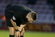 Chris Long of Northampton Taown lays on the ground as referee Robert Jones looks on during The Emirates FA Cup First Round match between Northampton Town and Scunthorpe United at Sixfields on November 4, 2017 in Northampton, England.