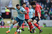 Josh Magennis of Northern Ireland and Minjae Kim of South Korea during the international friendly match between Northern Ireland and South Korea at Windsor Park on March 24, 2018 in Belfast, Northern Ireland.