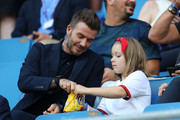 David Beckham is seen in the stands with his daughter, Harper, prior to the 2019 FIFA Women's World Cup France Quarter Final match between Norway and England at Stade Oceane on June 27, 2019 in Le Havre, France.