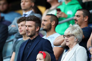 Harper Beckham, daughter of David Beckham sings the national anthem with her father during the 2019 FIFA Women's World Cup France Quarter Final match between Norway and England at Stade Oceane on June 27, 2019 in Le Havre, France.