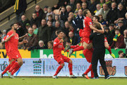Adam Lallana (1nd R) of Liverpool ceelbrates scoring his team's fifth goal with his manager Jurgen Klopp (2nd R) and team mates Lucas Leiva (3rd L), Roberto Firmino (2nd L) and Emre Can (1st L)during the Barclays Premier League match between Norwich City and Liverpool at Carrow Road on January 23, 2016 in Norwich, England.
