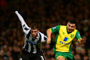 Davide Santon of Newcastle United and Robert Snodgrass of Norwich City compete for the ball during the Barclays Premier League match between Norwich City and Newcastle United at Carrow Road on January 28, 2014 in Norwich, England.
