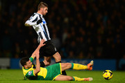 Davide Santon of Newcastle United and Robert Snodgrass of Norwich City battle for the ball during the Barclays Premier League match between Norwich City and Newcastle United at Carrow Road on January 28, 2014 in Norwich, England.
