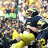 Tate Forcier Photos - Quarterback Tate Forcier #5 of Michigan is hugged by a teammate after scoring a touchdown late in the game against Notre Dame at Michigan Stadium on September 12, 2009 in Ann Arbor, Michigan. - Notre Dame v Michigan