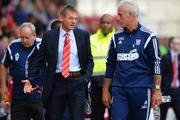 Stuart Pearce, Manager of Nottingham Forest walks out with Mick McCarthy, Manager of Ipswich Town during the Sky Bet Championship match between Nottingham Forest and Ipswich Town at City Ground on October 5, 2014 in Nottingham, England.