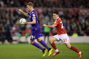 Darren Fletcher of Stoke City battles with Joe Lolley of Nottingham Forest during the Carabao Cup Third Round match between Nottingham Forest and Stoke City at City Ground on September 26, 2018 in Nottingham, England.