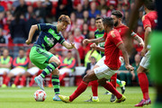 Sung-Yeung Ki of Swansea City controls the ball from Michael Mancienne of Nottingham Forest during the pre season friendly match between Nottingham Forest and Swansea City at City Ground on July 25, 2015 in Nottingham, England.