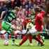 Sung-Yeung Ki Photos - Sung-Yeung Ki of Swansea City controls the ball from Michael Mancienne of Nottingham Forest during the pre season friendly match between Nottingham Forest and Swansea City at City Ground on July 25, 2015 in Nottingham, England. - Nottingham Forest v Swansea City - Pre Season Friendly
