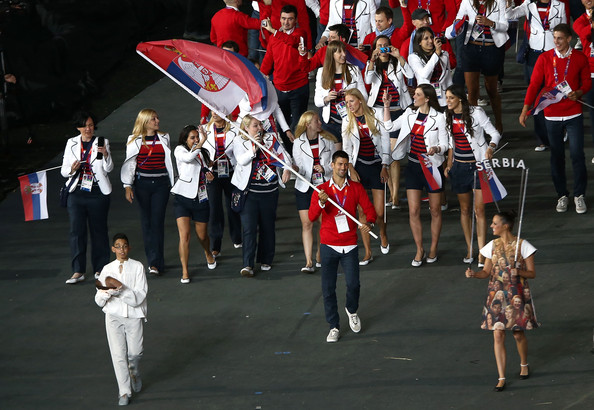 Novak Djokovic Novak Djokovic of the Serbia Olympic tennis team carries his country's flag during the Opening Ceremony of the London 2012 Olympic Games at the Olympic Stadium on July 27, 2012 in London, England.