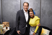 Charlie Rose (L) and DJ Princess Cut attend the O Magazine surprise celebration for Gayle King's 60th birthday on December 16, 2014 in New York City.