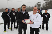O2 CEO Ronan Dunne (L) holds a ball with England coach Stuart Lancaster, looking on are  England players Dylan Hartley; Toby Flood, Chris Robshaw; Ben Foden; Ben Youngs as the RFU announce a renewed four year deal with O2 at the Pennyhill Park Hotel on February 6, 2012 in Bagshot, England