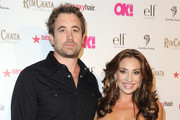 TV personalities Christian Rovsek and Lizzie Rovsek attend OK Magazine's So Sexy L.A. Event at LURE on May 21, 2014 in Los Angeles, California.