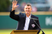 Former Cleveland Indians great Jim Thome waves to the crowd after being inducted into the Indians Hall of Fame prior to the game against the Oakland Athletics at Progressive Field on July 30, 2016 in Cleveland, Ohio.