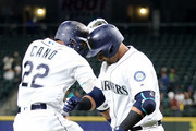 Robinson Cano #22 celebrates with Nelson Cruz #23 of the Seattle Mariners after hitting a solo homerun against the Oakland Athletics in the first inning during their game at Safeco Field on September 24, 2018 in Seattle, Washington.