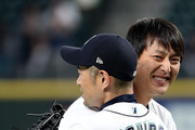 Former Seattle Mariners starting pitcher Hisahsi Iwakuma (L) hugs Ichiro Suzuki #51 of the Seattle Mariners after throwing out the ceremonial first pitch prior to the Seattle Mariners taking on the Oakland Athletics during their game at Safeco Field on September 26, 2018 in Seattle, Washington.
