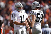 Sebastian Janikowski #11 celebrates his field goal with Jon Condo #59 of the Oakland Raiders during the first quarter against the Cleveland Browns at FirstEnergy Stadium on September 27, 2015 in Cleveland, Ohio.