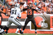 Josh McCown #13 of the Cleveland Browns throws a pass in front of the defense of Justin Tuck #91 of the Oakland Raiders during the second quarter at FirstEnergy Stadium on September 27, 2015 in Cleveland, Ohio.
