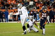 Kicker Sebastian Janikowski #11 hangs his head as punter Marquette King #7 of the Oakland Raiders and cornerback Chris Harris #25 of the Denver Broncos watch the flight of a missed field goal attempt by Janikowski of the Oakland Raiders at Sports Authority Field at Mile High on December 13, 2015 in Denver, Colorado.