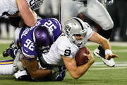 Christian Ponder #9 of the Oakland Raiders is sacked by Justin Trattou #94 and Tom Johnson #92 of the Minnesota Vikings during the third quarter of the preseason game on August 22, 2015 at TCF Bank Stadium in Minneapolis, Minnesota. The Vikings defeated the Raiders 20-12.