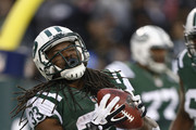 Chris Ivory #33 of the New York Jets celebrates his touchdown against the Oakland Raiders during their game at MetLife Stadium on December 8, 2013 in East Rutherford, New Jersey.