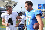 Derek Carr #4 of the Oakland Raiders and Philip Rivers #17 of the Los Angeles Chargers talk after a 26-10 Charger win at StubHub Center on October 7, 2018 in Carson, California.