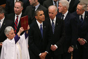 (L-R) U.S. President Barack Obama, Vice President Joseph Biden, former U.S. President Bill Clinton, and House Majority Leader Rep. Harry Reid (D-NV) watch as the casket of Sen. Daniel Inouye (D-HI) is carried past during a funeral service at the National Cathedral on December 21, 2012 in Washington, DC. Sen. Inouye, who was the most senior senator and a Medal of Honor recipient, died on December 17 at the age of 88.