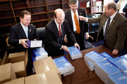 House Budget Committee members (L-R) Rep. Bill Flores (R-TX), Rep. Scott Garrett (R-NJ), Rep. Rob Woodall (R-GA) and Rep. Reid Ribble (R-WI) unload boxes of President Barack Obama's proposed FY2012 federal budget in the Cannon House Office Building February 14, 2011 in Washington, DC. The budget proposal seeks to trim $1.1 trillion over 10 years mostly by freezing domestic discretionary spending. Republicans in the House say the budget doesn't go far enough in cutting federal spending.