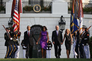 U.S. President Barack Obama, first lady Michelle Obama, Vice President Joseph Biden, his wife Jill Biden come out from the White House to observe a moment of silence to mark the 12th anniversary of the 9/11 attacks September 11, 2013 on the South Lawn of the White House in Washington, DC. The nation is commemorating the anniversary of the 2001 attacks which resulted in the deaths of nearly 3,000 people after two hijacked planes crashed into the World Trade Center, one into the Pentagon in Arlington, Virginia and one crash landed in Shanksville, Pennsylvania.